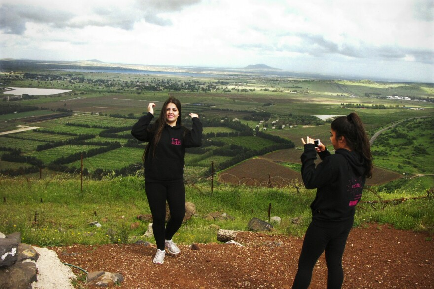 Israeli students snap photos of the Syrian landscape from Mount Bental in the Golan Heights, which is occupied by Israel. Israelis have even watched Syrian troop and rebel movements from here.