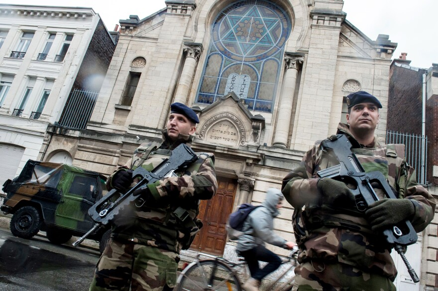 French soldiers stand guard in front of the entrance of a synagogue in Lille, northern France, earlier this month.