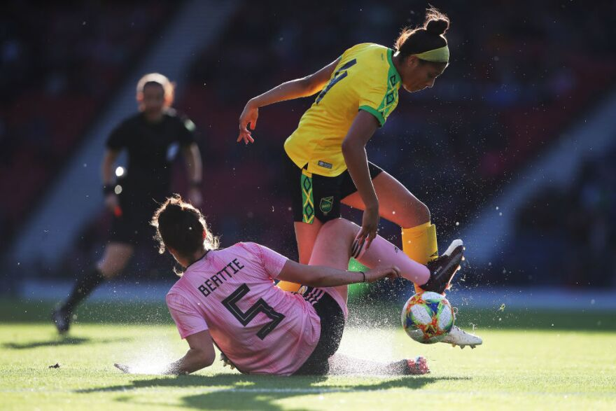 Jamaican star forward, Khadija Shaw, battles for the ball during a friendly match against Scotland in Jamaica's last game before the Women's World Cup.