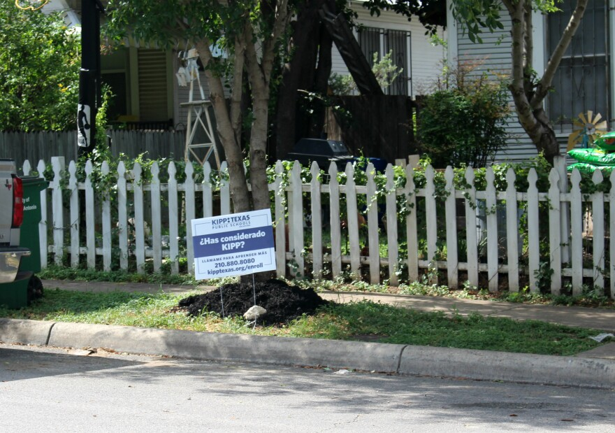 A yard sign advertising for the KIPP charter school network sits across the street from SAISD's Beacon Hill Academy in May 2019..