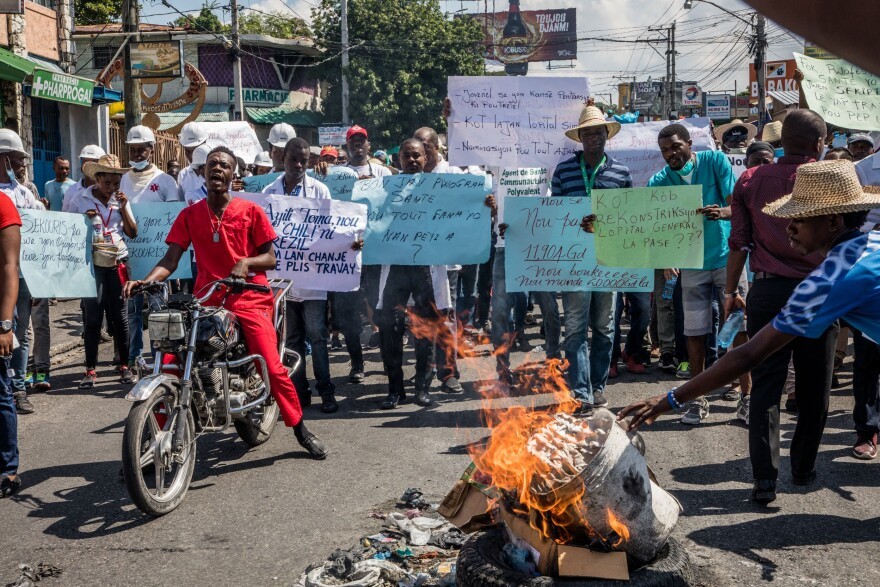 Medical professionals and other protesters demand the resignation of President Jovenel Moïse in Port-au-Prince in October. Moïse has been accused of embezzling aid money.