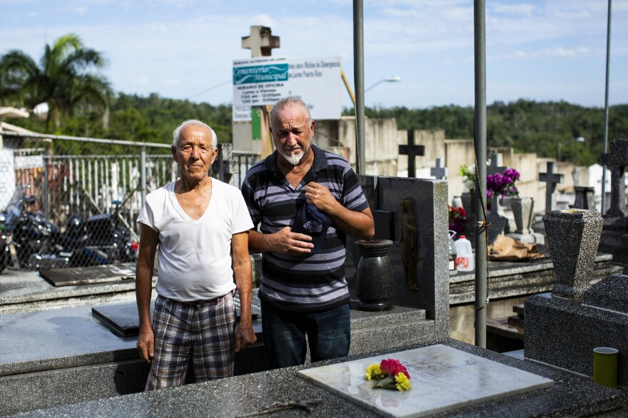 William González Rodríguez, 79, (left) stands at his wife's grave along with his son Orlando González, 54. They were among the visitors who actually gained access to their loved ones' graves on Sunday.