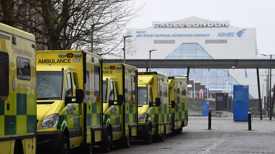 Ambulances are parked outside the NHS Nightingale hospital at the ExCeL center in east London on Friday. Hospitals in the U.K. are preparing for an influx of patients as the coronavirus continues to spread.