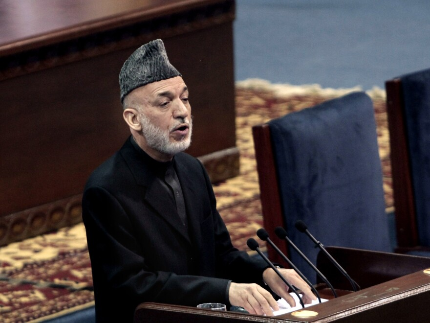 """Karzai told the gathering he supports a security deal with the U.S., but he didn't hide his troubled relationship with the Americans. """"They don't trust me, and I don't trust them,"""" he said."""