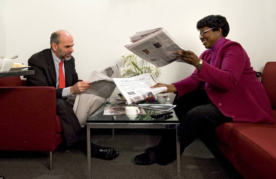 Gerald Seib (left) and Gwen Ifill go over the news before filming ABC's <em>This Week</em> at the Newseum in Washington, D.C., in December 2008.
