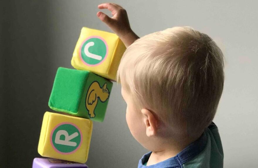 ryanfields-unsplash-child-with-blocks-developmental-delays.jpg