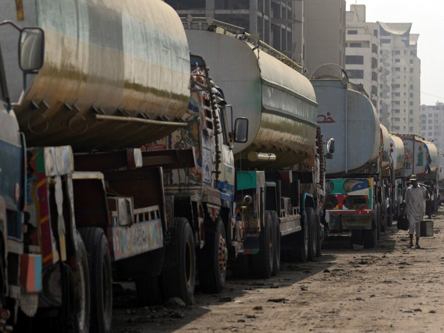 Fuel trucks are backed up in Karachi, Pakistan. U.S. negotiators spent more than a month talking with Pakistan about reopening supply routes from Pakistan to Afghanistan. Pakistan reportedly wants about $3,000 for each trip, while the U.S. is reportedly offering about $1,000.
