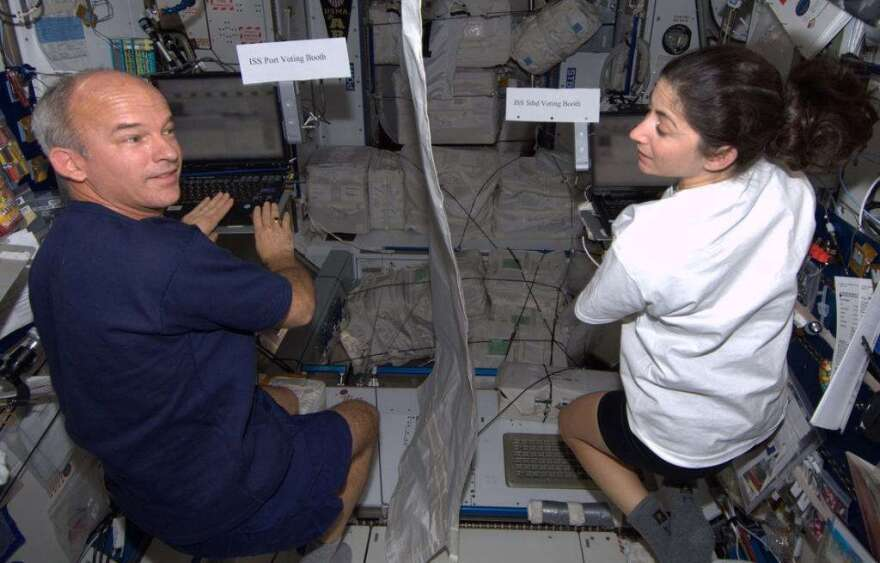 NASA astronauts Jeff Williams and Nicole Stott vote from space via email. Photo: NASA / Nicole Stott