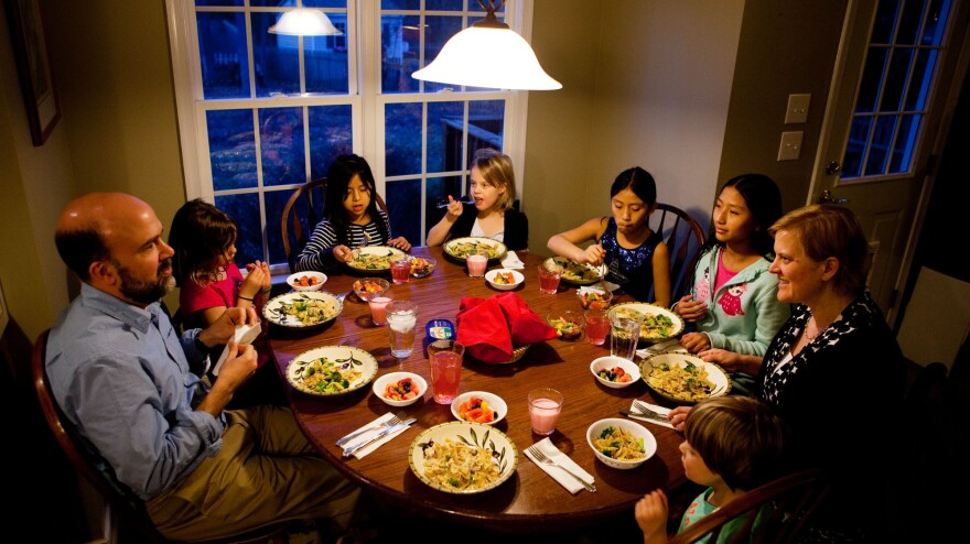 """Americans are dining out less and eating at home more, new government research shows. This may mean more <a href=""""http://www.npr.org/blogs/thesalt/2013/02/26/172897660/family-dinner-treasured-tradition-or-bygone-ideal"""">family dinners</a>, like this one at the Brown-Spencer home in Mechanicsville, Va."""
