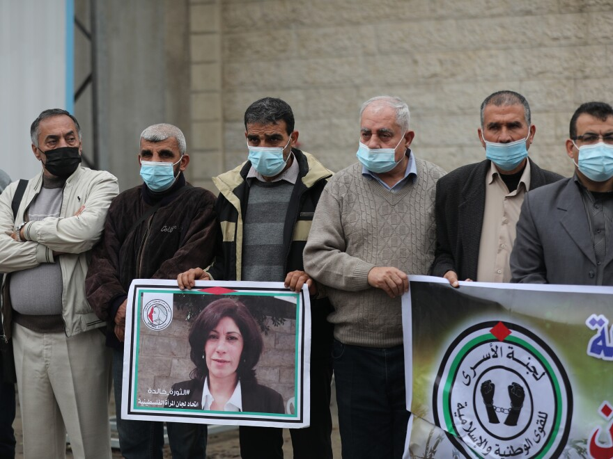 Members of the Palestinian Prisoner Society stage a demonstration outside the International Committee of the Red Cross building, demanding the World Health Organization put pressure on Israeli authorities to vaccinate Palestinian prisoners in Israeli jails, in Gaza City, on Jan. 3.