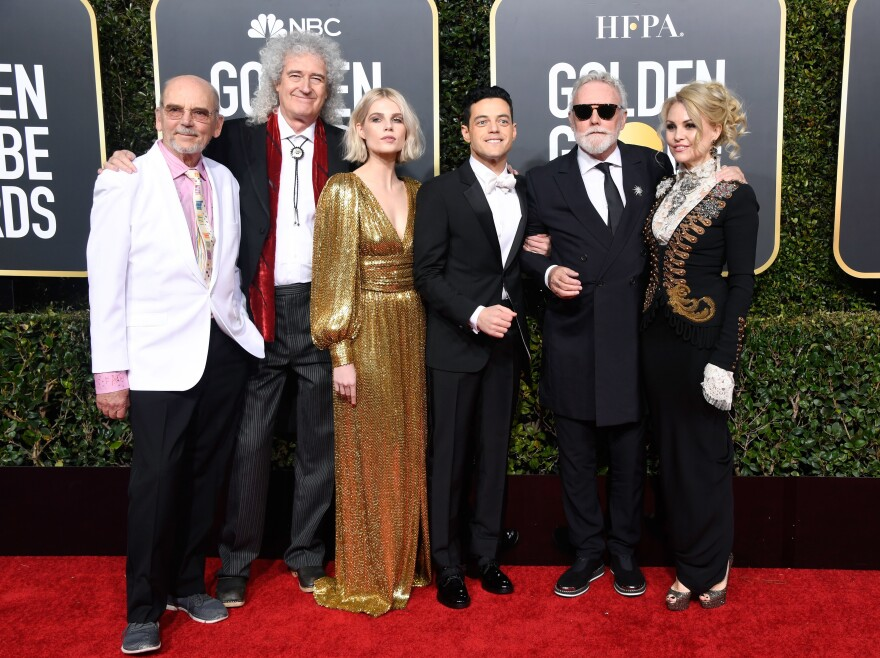 Brian May, 2nd left; Lucy Boynton, 3rd left;, Rami Malek 3rd right;, and Roger Taylor