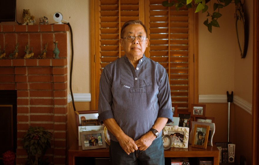 The author's father, Manolo Guerra, stands for a portrait at his home in Moreno Valley, Calif., on Aug. 7.