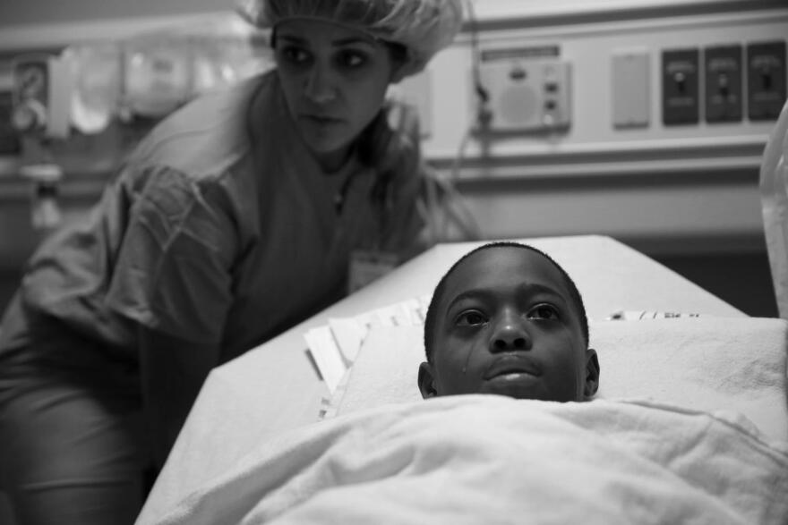 Tavon Tanner tears up before his surgery at Lurie Children's Hospital in October 2016. This photograph is part of the <em>Chicago</em> <em>Tribune </em>series that earned E. Jason Wambsgans the 2017 Pulitzer Prize.