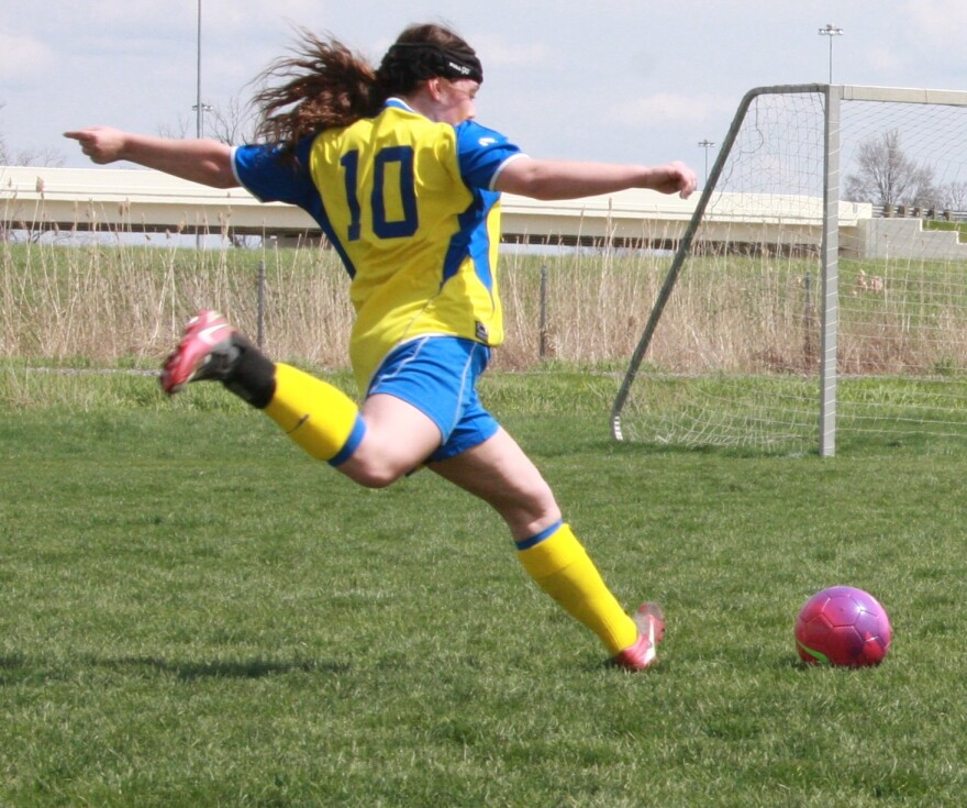 A photo of a girl playing soccer.