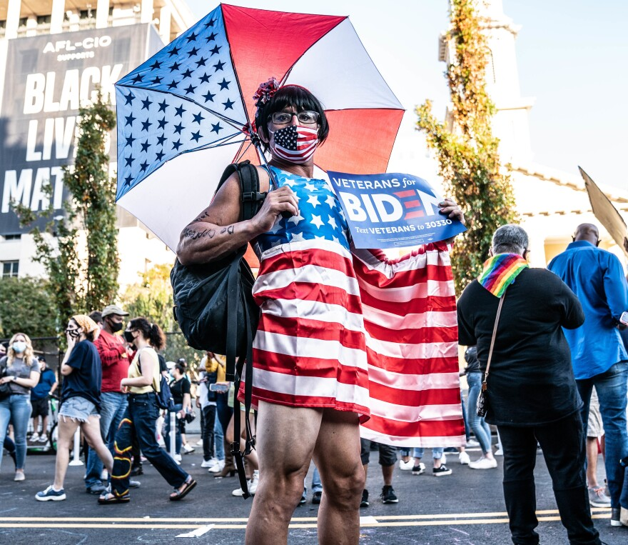 <strong>WASHINGTON, D.C.:</strong> Matt wears a flag outfit on Black Lives Matter Plaza after hearing that Joe Biden and Kamala Harris has won the election.