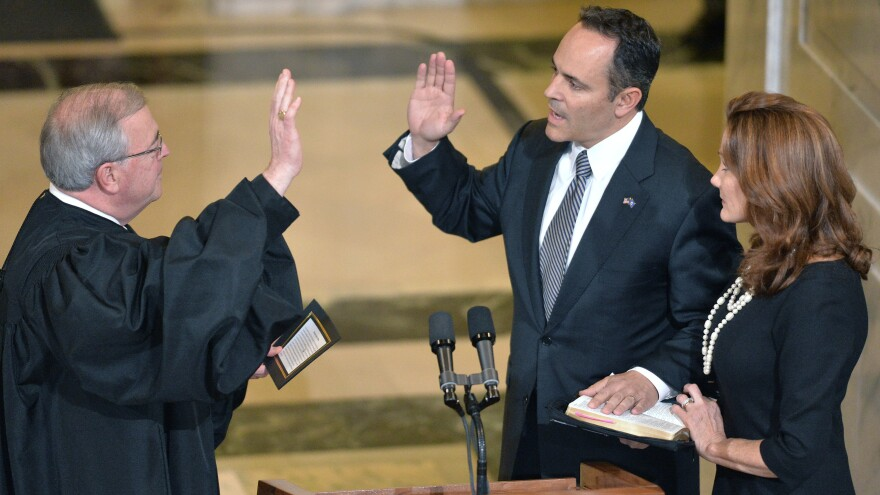 Matt Bevin (center), was sworn in as Kentucky's new governor Tuesday. One of the first issues he'll confront is how far to take his pledge to roll back parts of the state's Medicaid expansion under the Affordable Care Act.