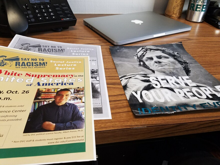 Flyers for Ponce's talk about white supremacy in the United States sit next to a flyer for Identity Evropa, a white supremacist group.