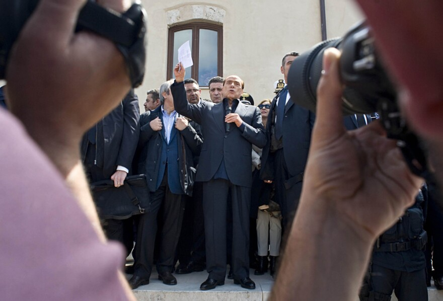 Premier Silvio Berlusconi addresses the migrant crisis during a visit to the tiny Italian island of Lampedusa on Wednesday.