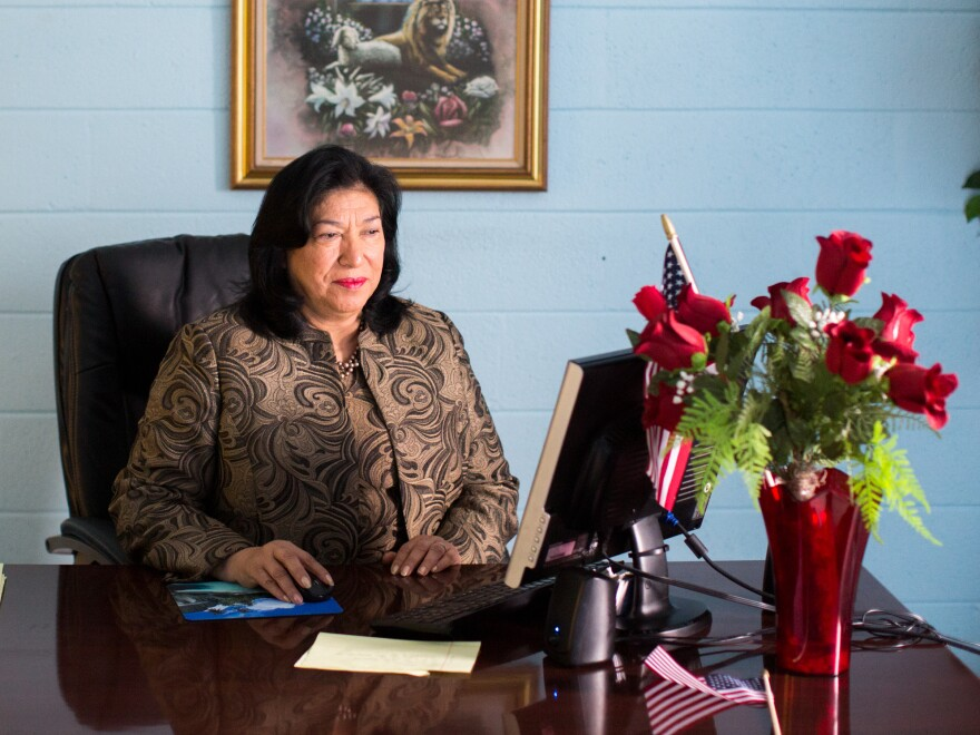 Maudia Melendez, minister at Jesus Ministry Inc., sits at her desk inside Statesville Road Baptist Church in Charlotte, N.C.