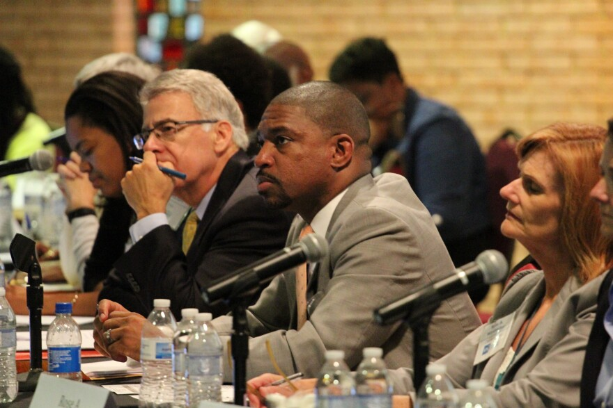 Members of the Ferguson Commission listen to testimony at a 2015 meeting. The commission, which was appointed by former Missouri Gov. Jay Nixon, released recommendations for law enforcement, education and public health changes in September 2015.