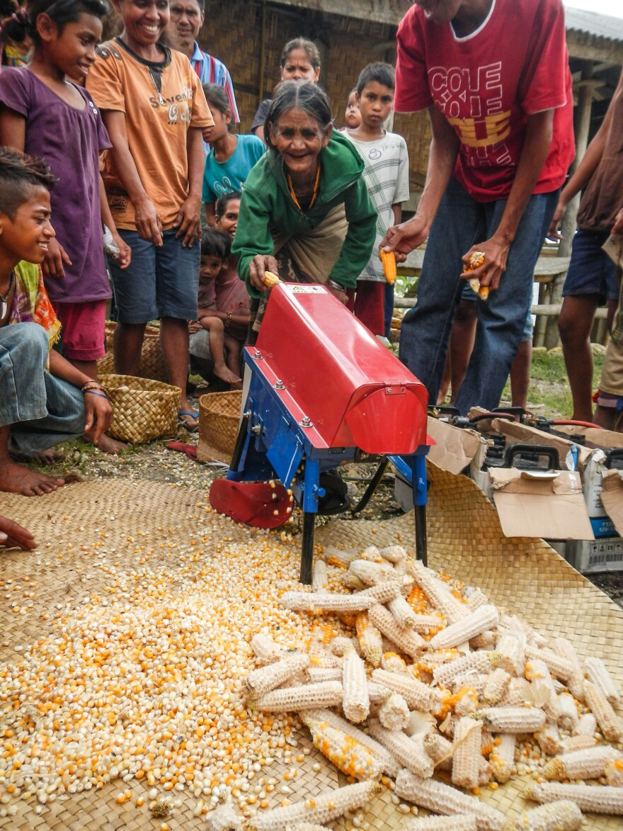These farmers in Indonesia used to remove corn kernels by hand. Village Infrastructure Angel's solar-powered mill speeds up the process.