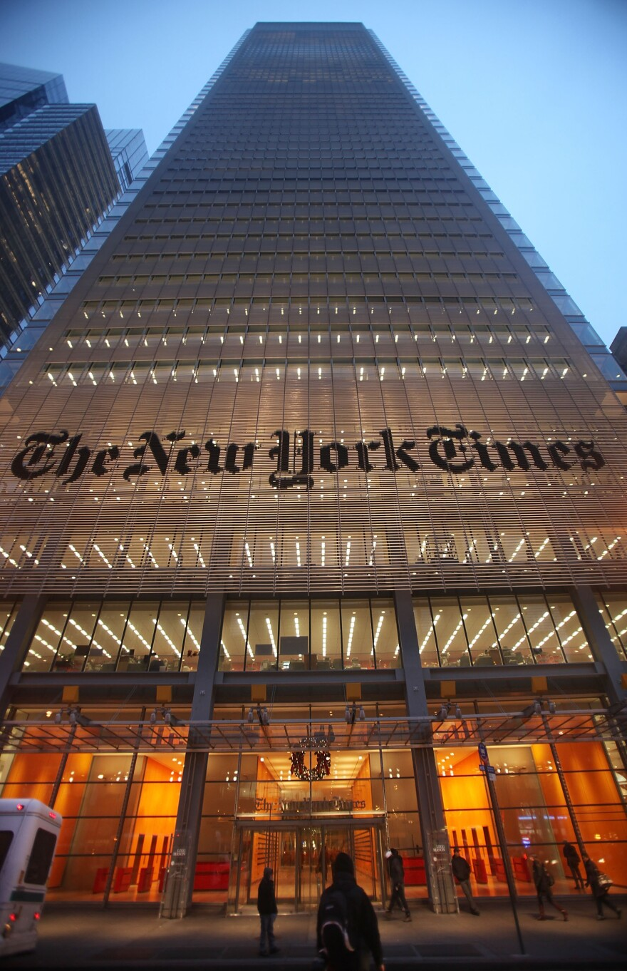 <em>The New York Times</em> sign is displayed in front of the newspaper's midtown headquarters in New York City.