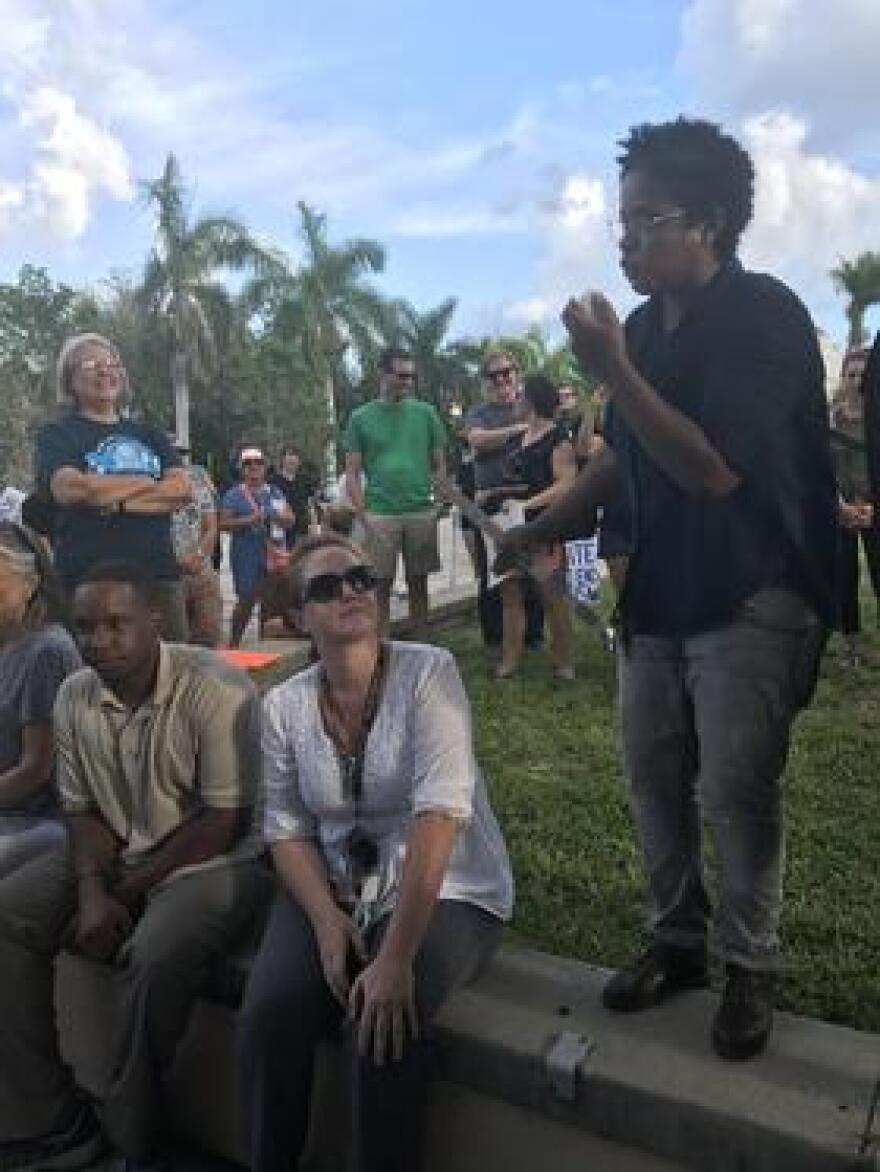 Black Lives Matter Manasota leader Shakira Refos telling protesters, who want the Confederate statue removed, not to interact with the counter protesters, who want the Confederate statue to stay, waiting for them at the Manatee County courthouse.