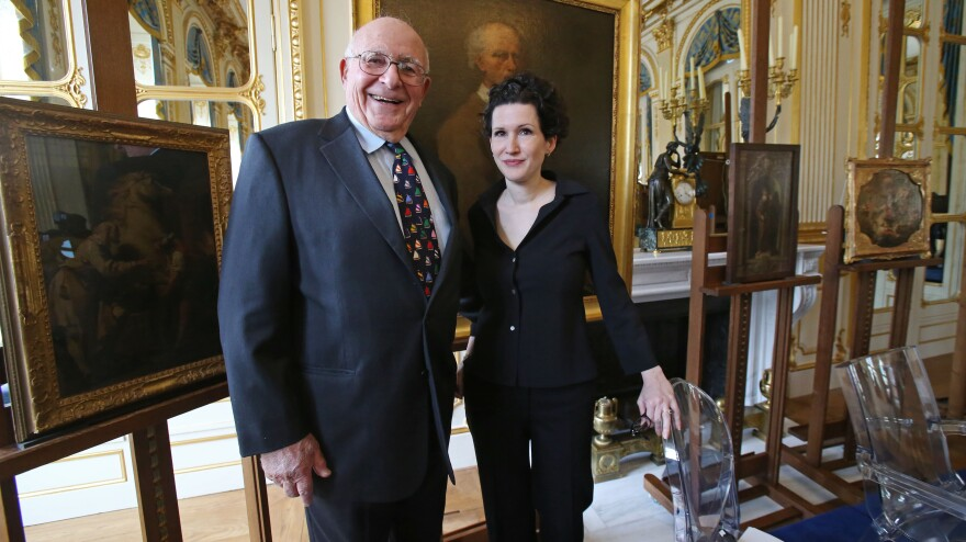 American Thomas Selldorff and Austrian art historian Sophie Lillie, who helped him identify the paintings, pose for the media during a ceremony at the Culture Ministry in Paris on March 19 to return paintings taken from their Jewish owners during World War II. Selldorff, 82, was a young boy when the Nazis took the paintings from his grandfather.