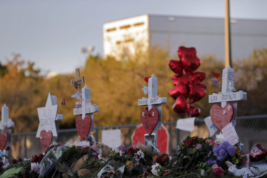 A makeshift memorial is seen outside the Marjory Stoneman Douglas High School, where 17 students and faculty were killed in a mass shooting in Parkland, Fla., in 2018. (Gerald Herbert/AP)