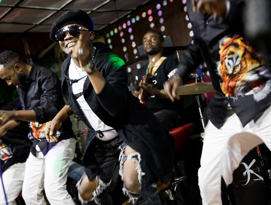 Performers play rumba music onstage at the Ibiza dance club in Goma.