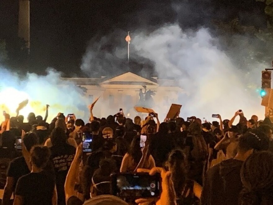 Clouds of tear gas obscure the North Portico of the White House, where protesters in Washington, D.C., gathered Sunday night.