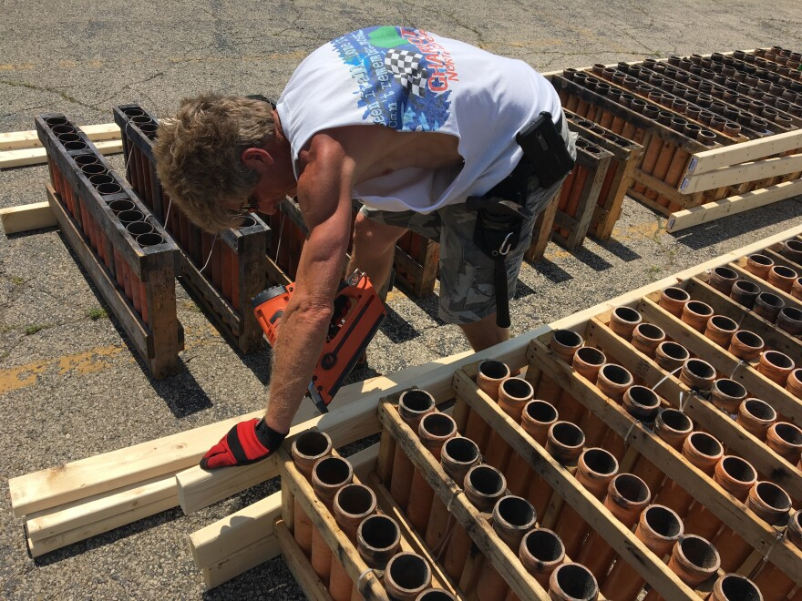Dave Wallen constructs wooden frames for the guns that will launch Dayton's fireworks display on July 3rd
