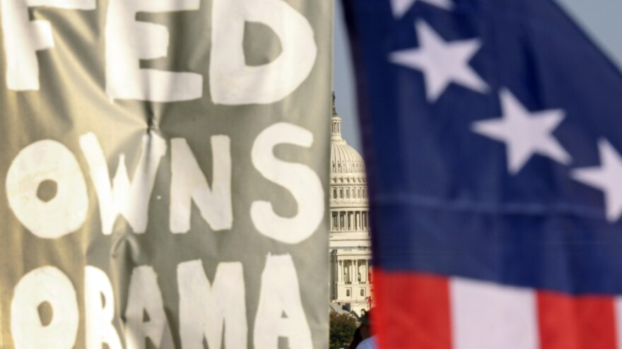 """<p>A sign at an Occupy D.C. protest reads """"Fed Owns Obama."""" The president has so far had the worst of both worlds, with much of Wall Street convinced he's anti-business, and the protesters convinced he's in bed with the banks. </p>"""
