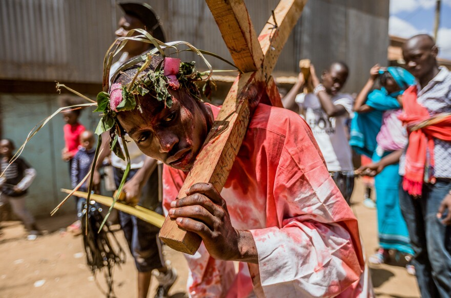 Christian devotees reenact the Way of the Cross, or Jesus Christ's passion, during a Good Friday commemoration in the Kibera slum of Nairobi on Friday.