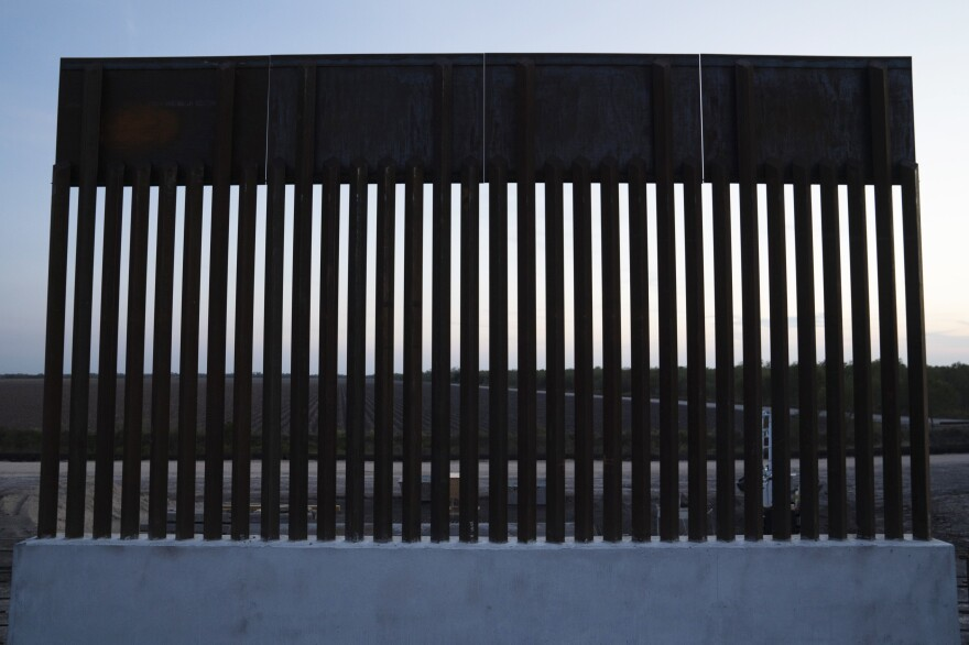 A section of the new 18-foot border wall is built in Donna, Texas. The new wall construction is already falling behind schedule because of the difficulty of acquiring private land.