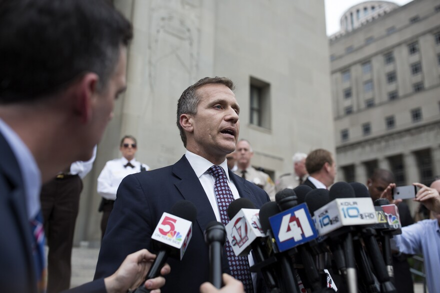 Governor Eric Greitens speaks to reporters outside the Civil Courts Building in downtown St. Louis after his felony invasion of privacy charge was dropped. May 14, 2018