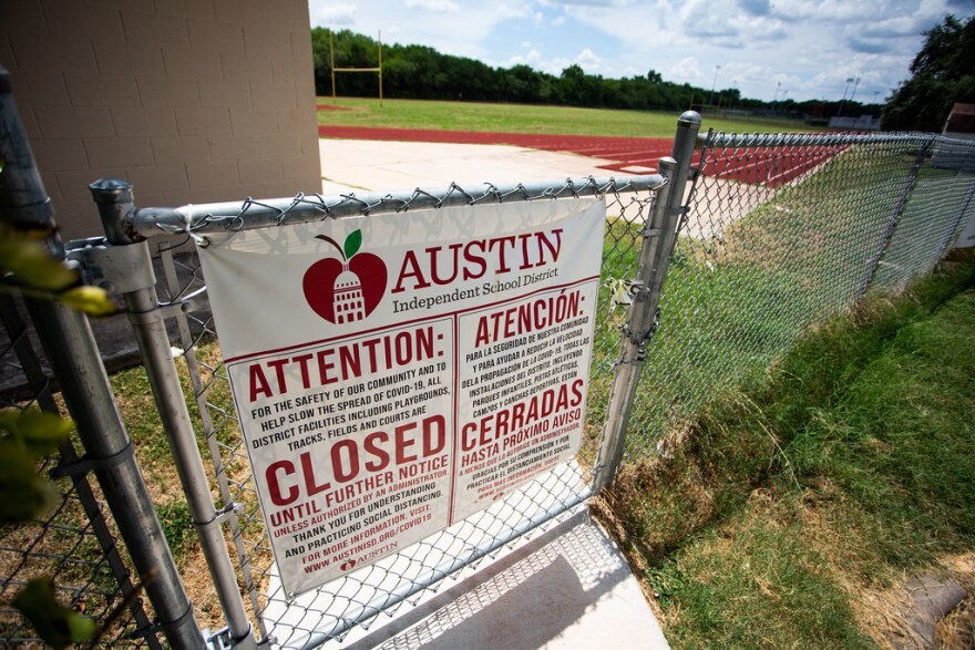 A sign at Crockett High Schools says the building is closed until further notice because of the coronavirus.