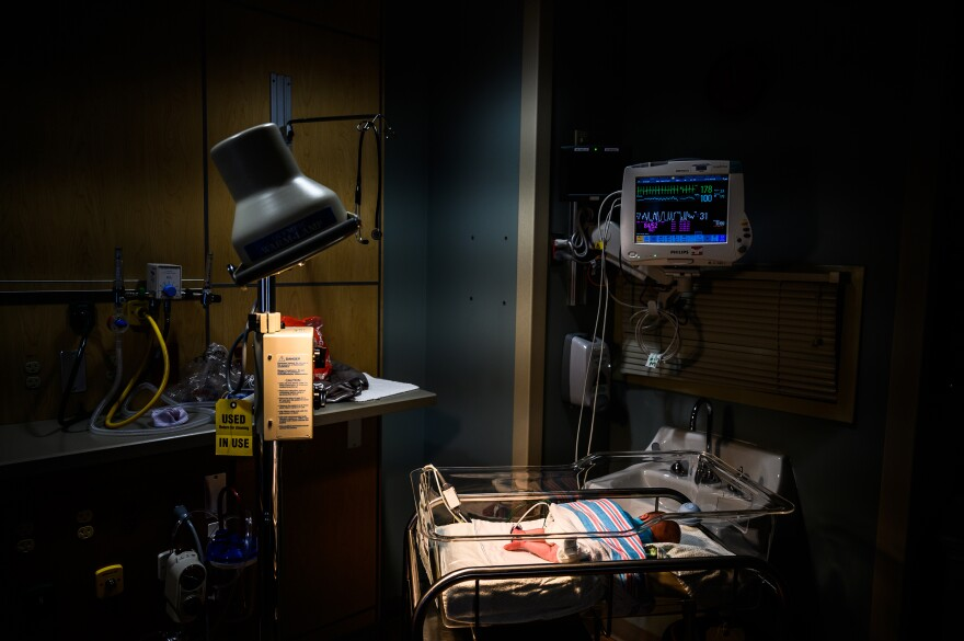 An infant born dependent on opioids receives care at a neonatal intensive care unit in Charleston, W.Va. Costs associated with treating such infants reached $800 million in 2018.