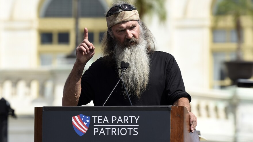 <em>Duck Dynasty</em> star Phil Robertson speaks during a rally opposing the Iran nuclear deal outside the Capitol. The Ted Cruz campaign announced Robertson's endorsement of the Texas senator Tuesday.