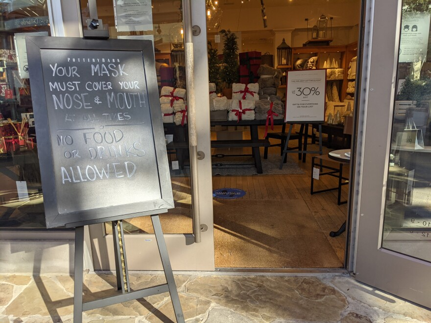 "A sign outside a shop reads ""Your mask must cover your nose and mouth at all times. No food or drinks allowed."""