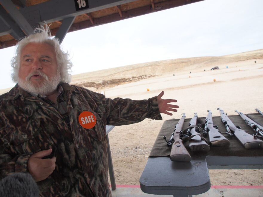 [FILE] A gun collector shows off several vintage rifles at an Idaho gun range. The FBI says 2019 was likely a record year for firearm-related background checks, often a barometer for gun sales. But industry analysts say there were likely only modest gains for the gun industry.