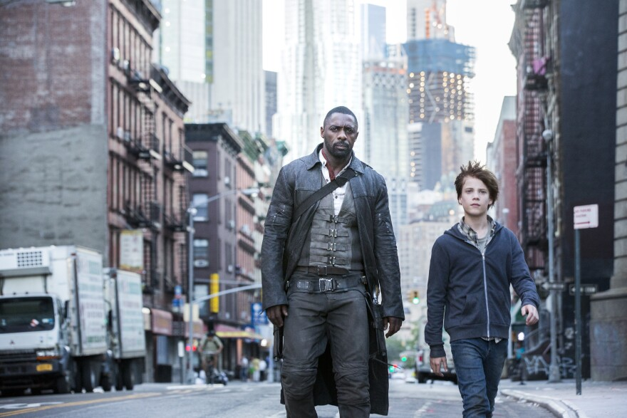 "Roland, played by Idris Elba, and Jake, played by Tom Taylor, in Columbia Pictures' ""The Dark Tower."""