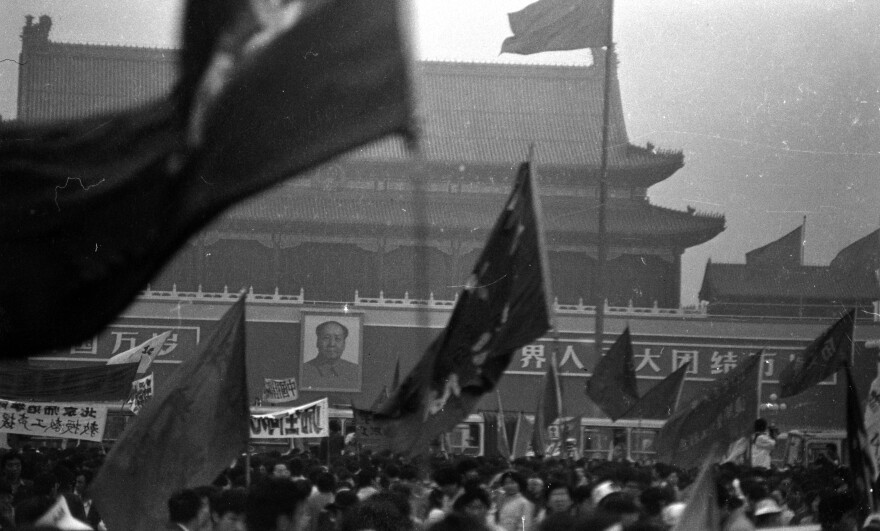 Protesters wave flags on Beijing's Tiananmen Square in the weeks leading up to the violent crackdowns on June 4. These photos were donated to Humanitarian China by the photographer, Jian Liu, then one of the student protesters.