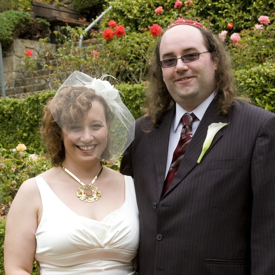 Hope Barrone-Falk and J.D. Falk on their wedding day in 2009.