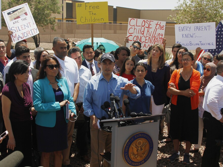 Rep. Joaquin Castro, D-Texas, speaks alongside members of the Hispanic Caucus after touring the Border Patrol station in Clint, Texas, on Monday.