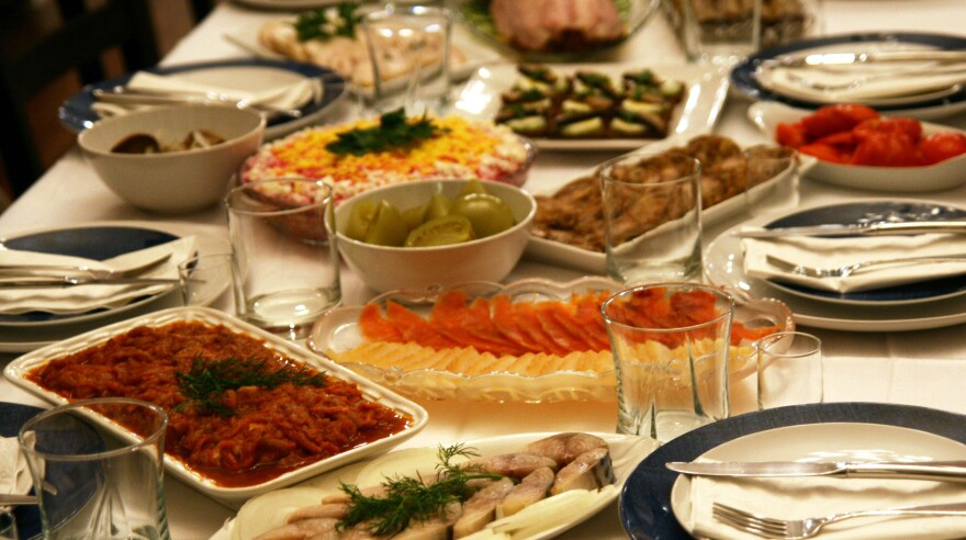 <em>Zakuski</em> tables, like Slava and Luba Frumkin's, are known for their largesse. This spread includes smoked salmon and halibut, pickled green tomatoes, salted mackerel, Herring Under a Fur Coat and Georgian eggplant rolls.