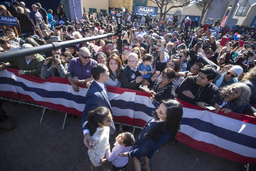 Castro's wife, Erica Lira, and children, Carina and Cristian, join him on stage after his announcement.