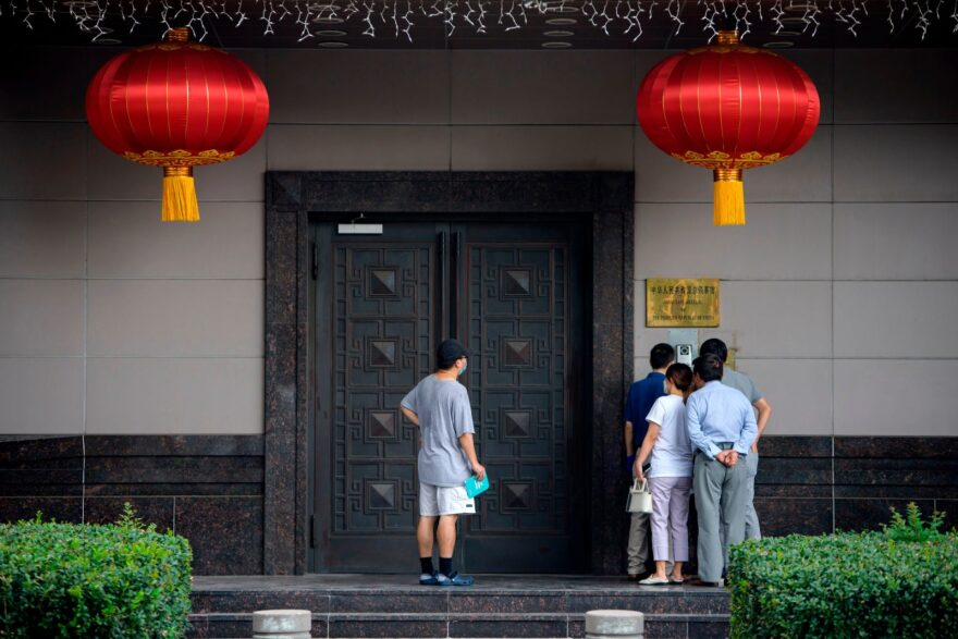 People attempt to talk to someone at the Chinese consulate in Houston on July 22, 2020. (Photo by MARK FELIX/AFP /AFP via Getty Images)