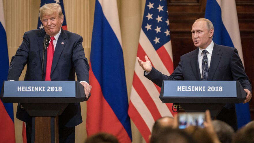 U.S. President Donald Trump and Russian President Vladimir Putin answer questions about the 2016 election during a joint press conference after their summit on July 16, 2018, in Helsinki, Finland.
