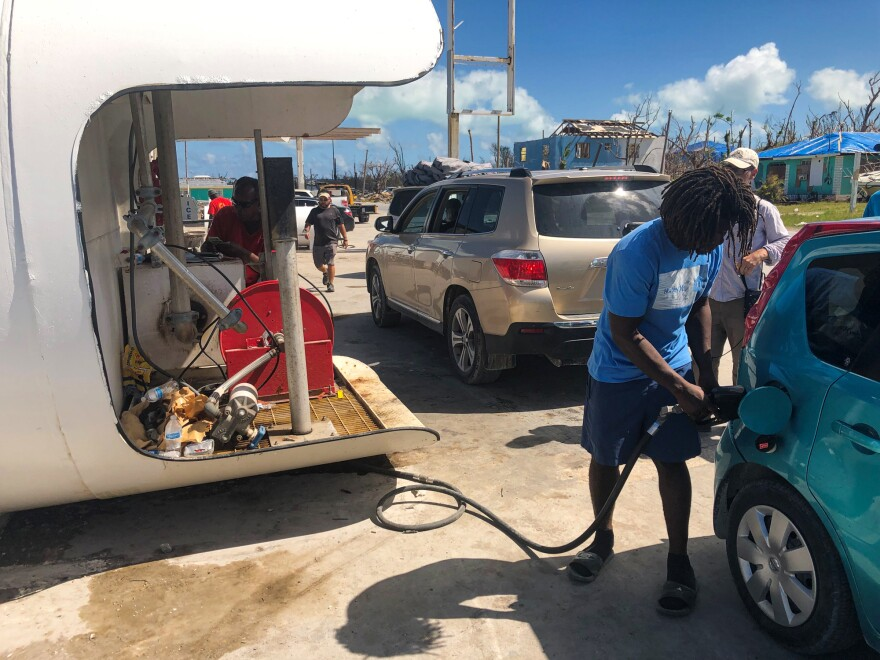 Fuel is pumped from a mobile gas tank set up at Abaco Battery and Tyre in Marsh Harbour, owned by Michael Jones. All the gas stations in Marsh Harbour were destroyed in the storm.